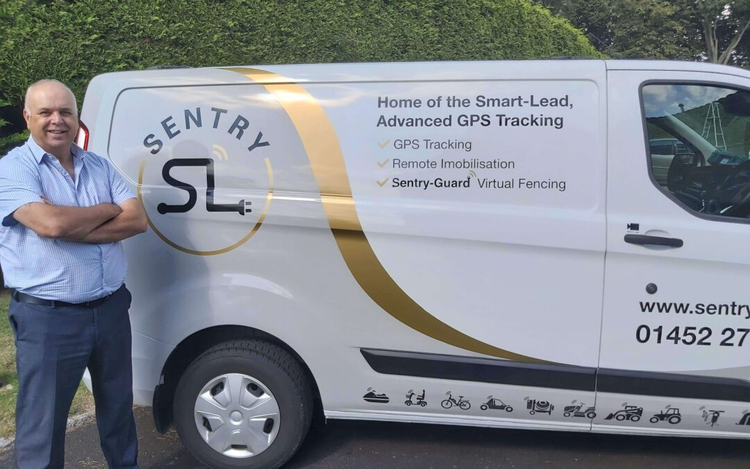 Photo of owner Steve Roberts with the Sentry SL company van
