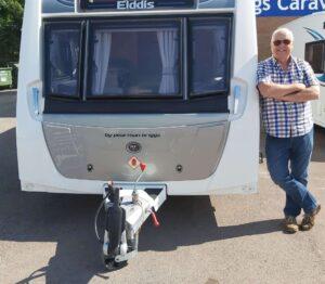 Photo of CEO Steve Roberts with his caravan